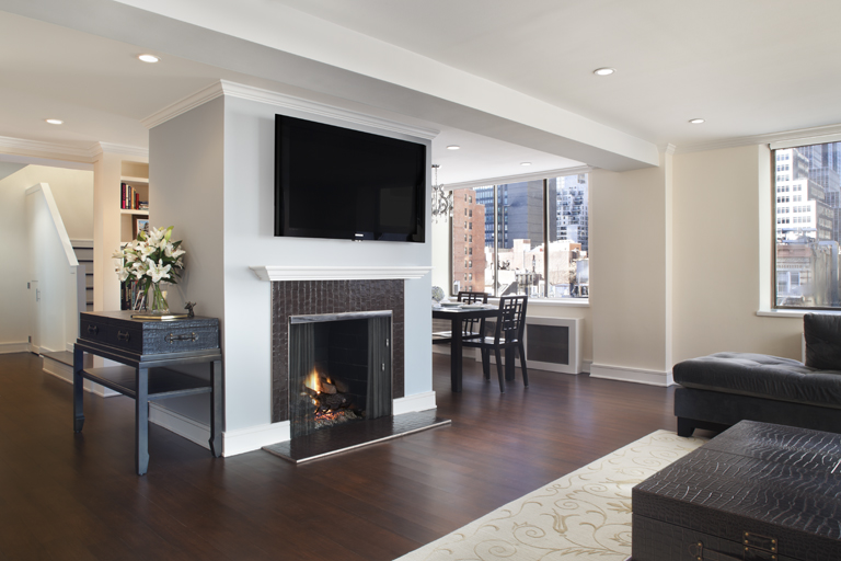 custom living room with fireplace (Midtown Duplex Gallery)
