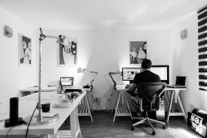 a person is working in an office room at home